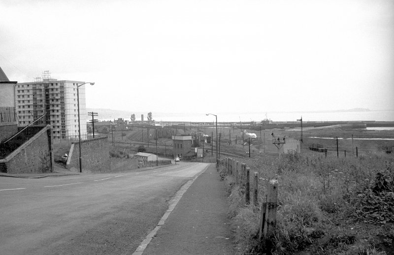 View looking ENE showing railway trucks with Methil Harbour in background and Swan Court on left