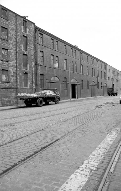 View from E showing NNE front of number 8a with number 8b in background and part of warehouse in foreground