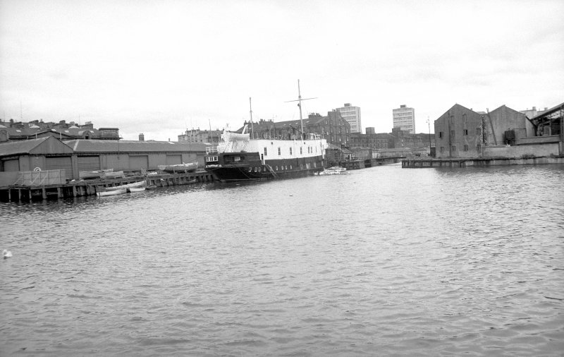 General view looking WSW showing Training Ship (TS) Dolphin beside entrance to dock with warehouse on right
