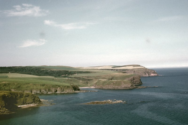 "Copy of colour slide showing distant view of Cullykhan, Castle Point, Troup, Banffshire Insc: ""General view of Castle Point and bay from Pennan"" NMRS Survey of Private Collection Digital Image only"