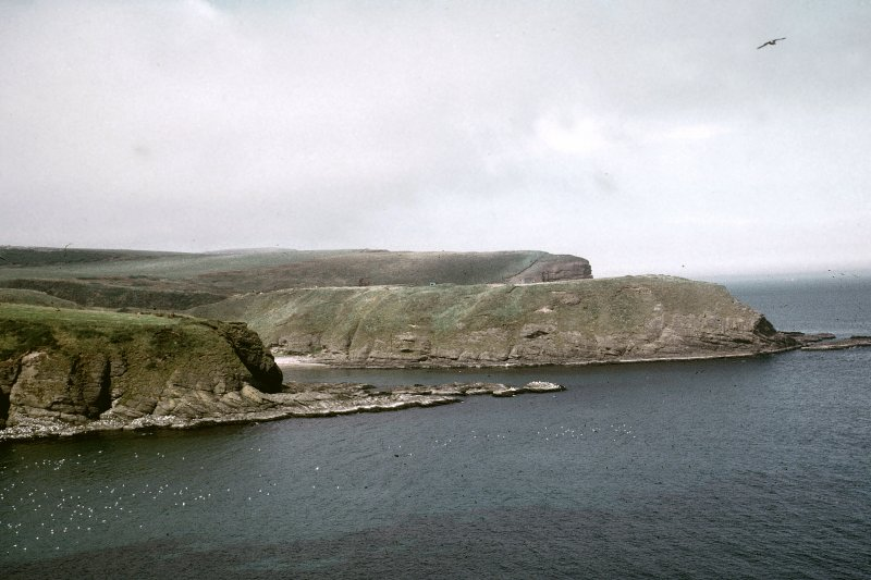 "Copy of colour slide showing distant view of Cullykhan, Castle Point, Troup, Banffshire Insc: "" View of Castle Point from Nethermill Head, mist rolling down"" NMRS Survey of Private Collection Digital Image only"