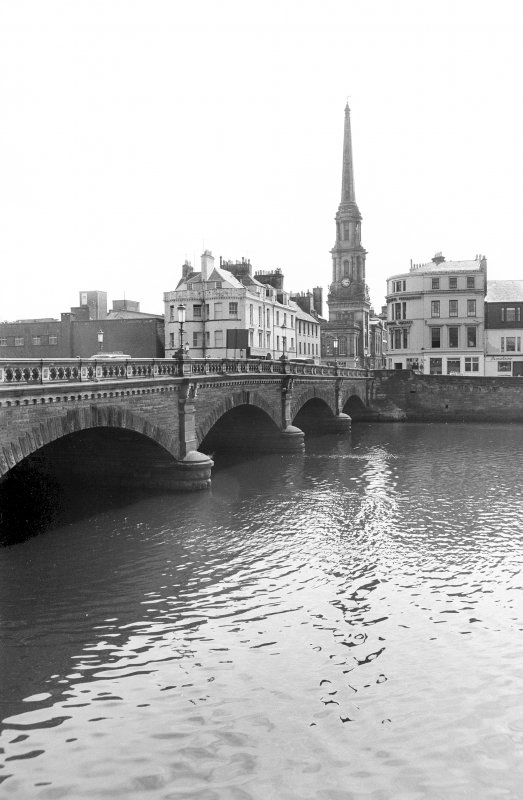 View looking S showing part of WNW front of bridge with number 2, numbers 3-17 New Bridge Street and Town Hall in background
