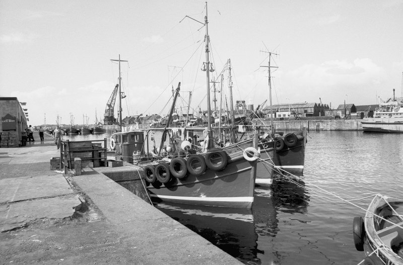 View from S showing fishing boats at S quay