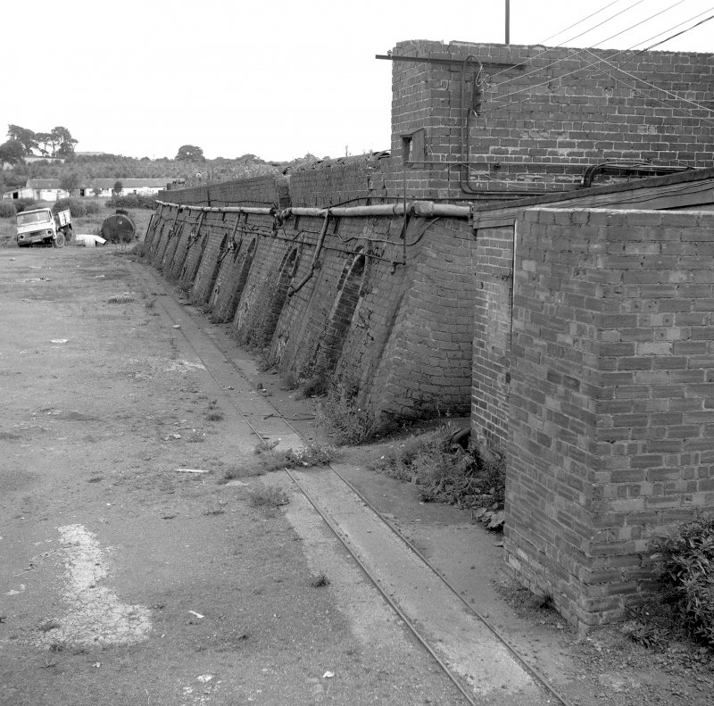 View of 'top kiln' (built early 1950s): 20 chamber continuous kiln - note rails for brick wagons Digital image of B 9356