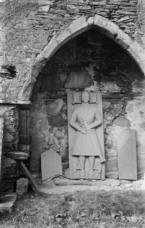 Oronsay Priory, interior. View of arch in north side of chancel with effigy beneath.
