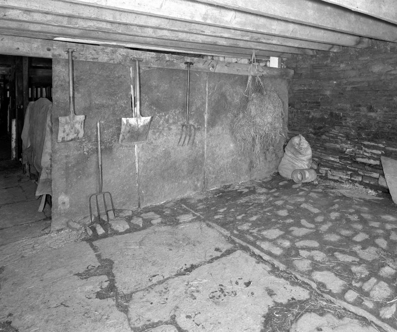 Stable, (former steading), interior view of East end showing Caithness slabs. Digital image of D 31006