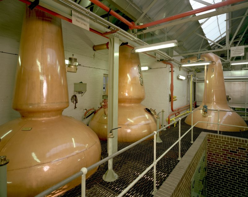 Still Room: view of 3 (steam-heated) stills (L to R): No 1 Low Wines Still, 9587 litres; Wash Still; No 2 Low Wines Still, 7628 litres, all R & G Abercrombie of Alloa, dated 1962. Rosebank is one of only 2 triple-distilled whiskies in Scotland Digital image of C 19607 CN