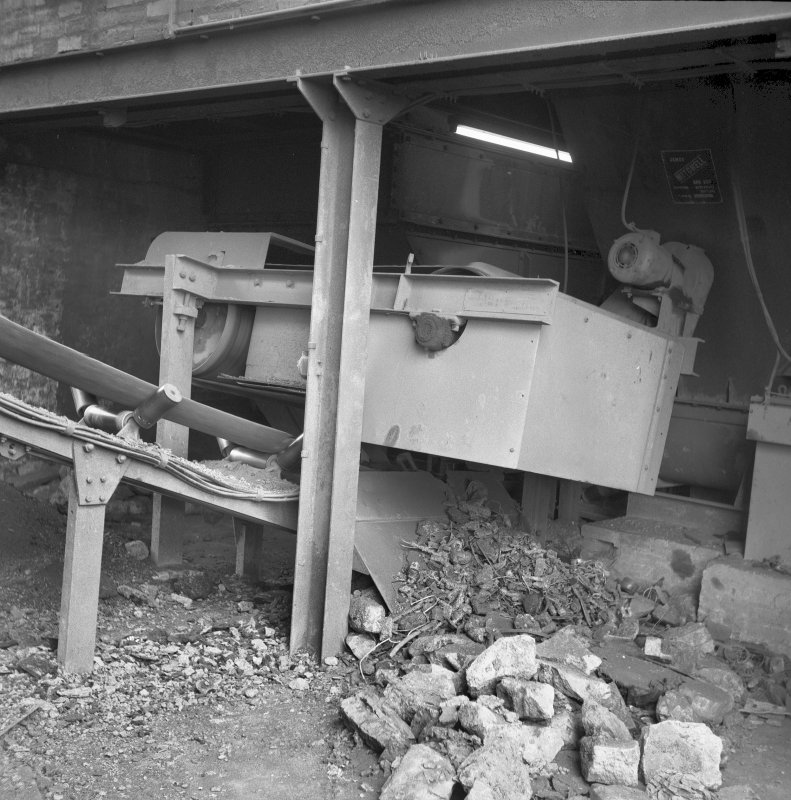 Interior View of magnetic belt over raw material supply conveyor to Pan mill Digital image of B/9371