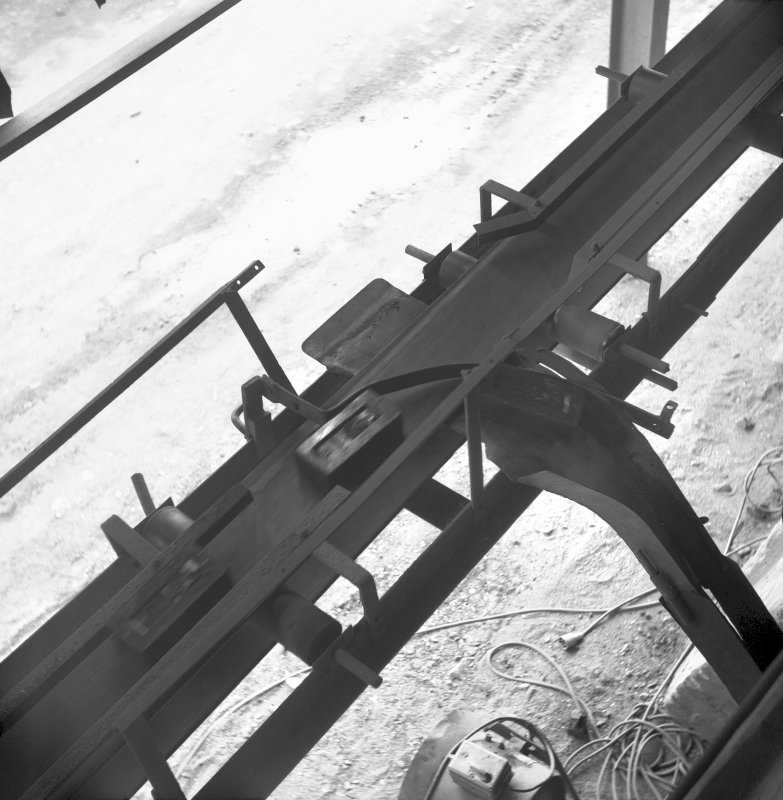 Interior View of bricks being guided down conveyor from brick press into chamber for setting Digital image of B/9376