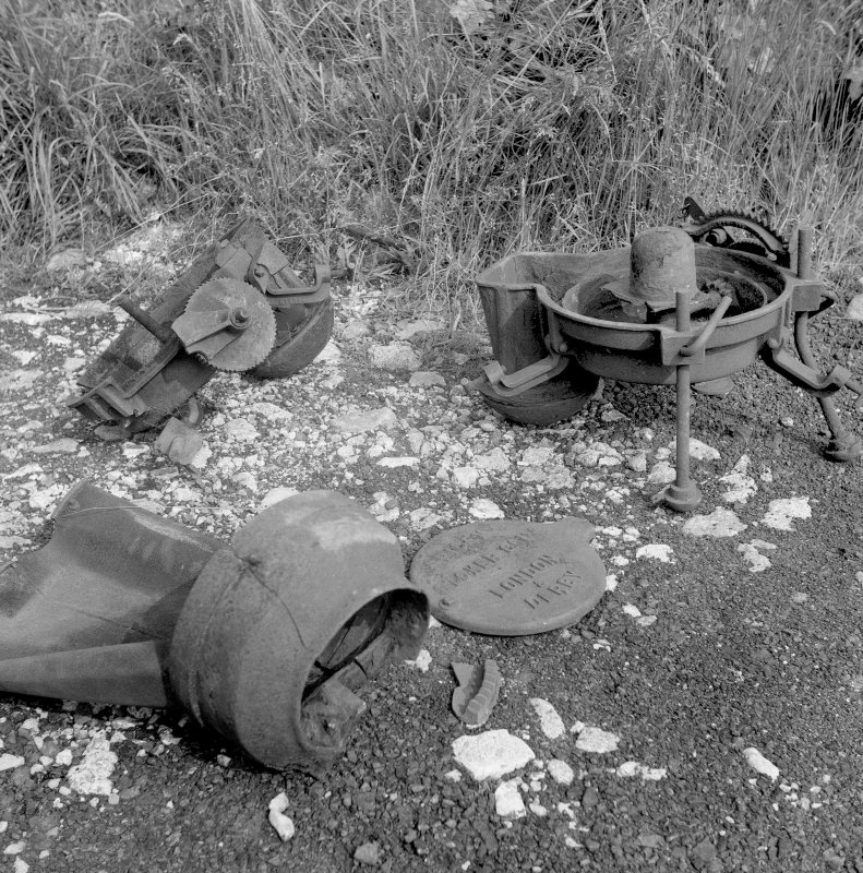 View of base of stoker (right) and damaged fuel bucket Digital image of B/9380