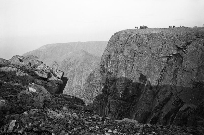 View of the Ben Nevis Observatory and precipice from a distance. Titled in Beveridge publication as 'Coire Leas and Summit of Ben Nevis'.