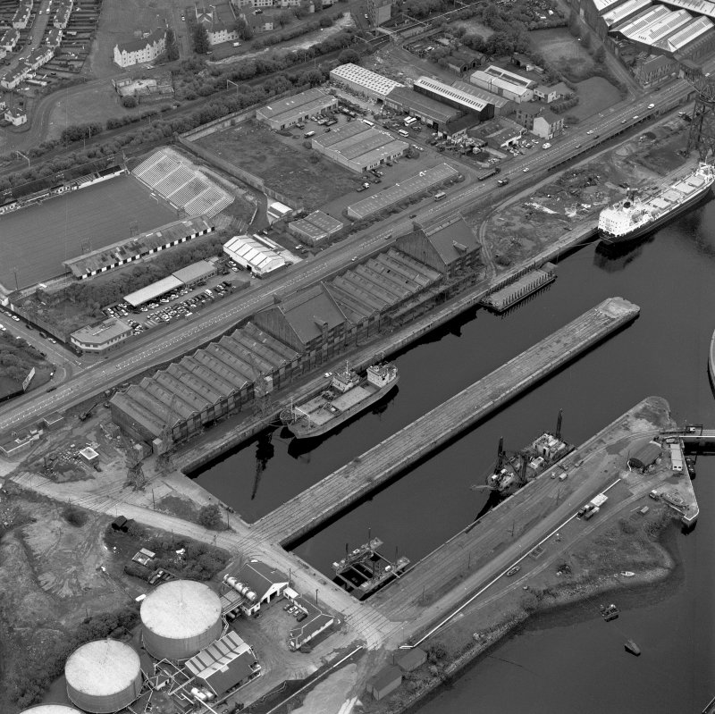 Greenock, James Watt Dock, oblique aerial view, taken from the ENE. Cappielow is visible in the top left-hand corner of the photograph.
