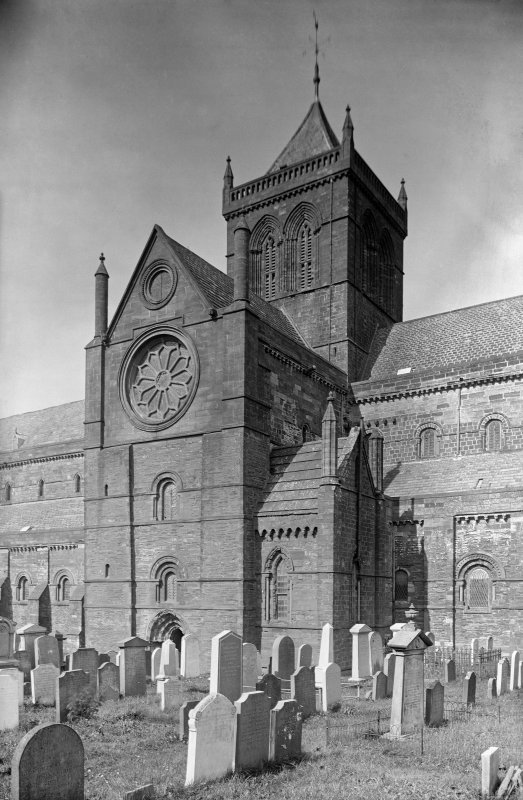 Kirkwall, St Magnus Cathedral. View from S showing part of SSW front of cathedral with part of graveyard in foreground.