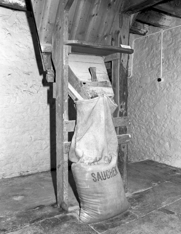 Detail of sack filler for dried grain after it is removed from the kiln floor, located at ground floor level. Digital image of C 3933.