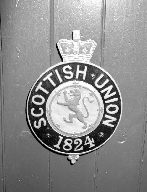 Detail of Insurance Company Plaque on door. Digital image of C 3938.