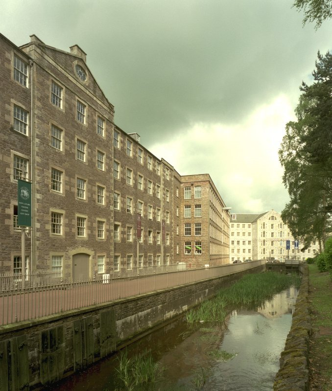 New Lanark: view from E of lade as it passes in front of Mill No. 3, with Mills No. 2 and 1 in the distance