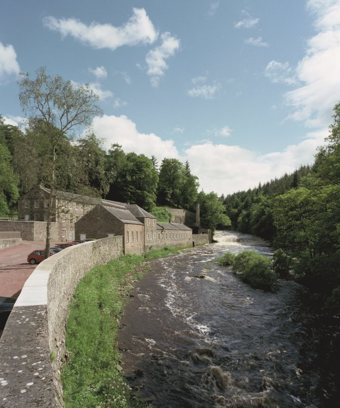 New Lanark: general view from N showing Dye Works in the context of the River Clyde