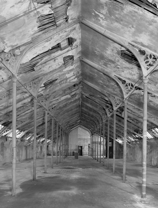 Interior. View of top flat of mill from East showing ornate perpendicular gothic cast iron roof trusses.