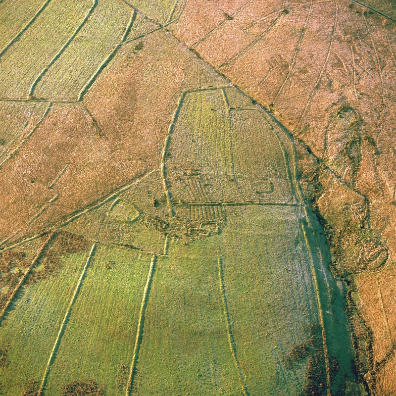 Oblique aerial view of Ettleton Sike centred on the remains of a farmstead, field-system, rig and boundary banks with further boundary banks and rig adjacent, taken from the ENE.
