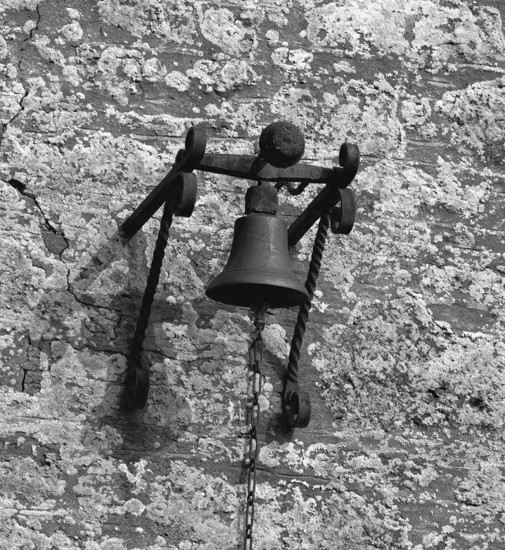 Detail of bell on wall to right of entrance to courtyard. Digital image of D 47361.