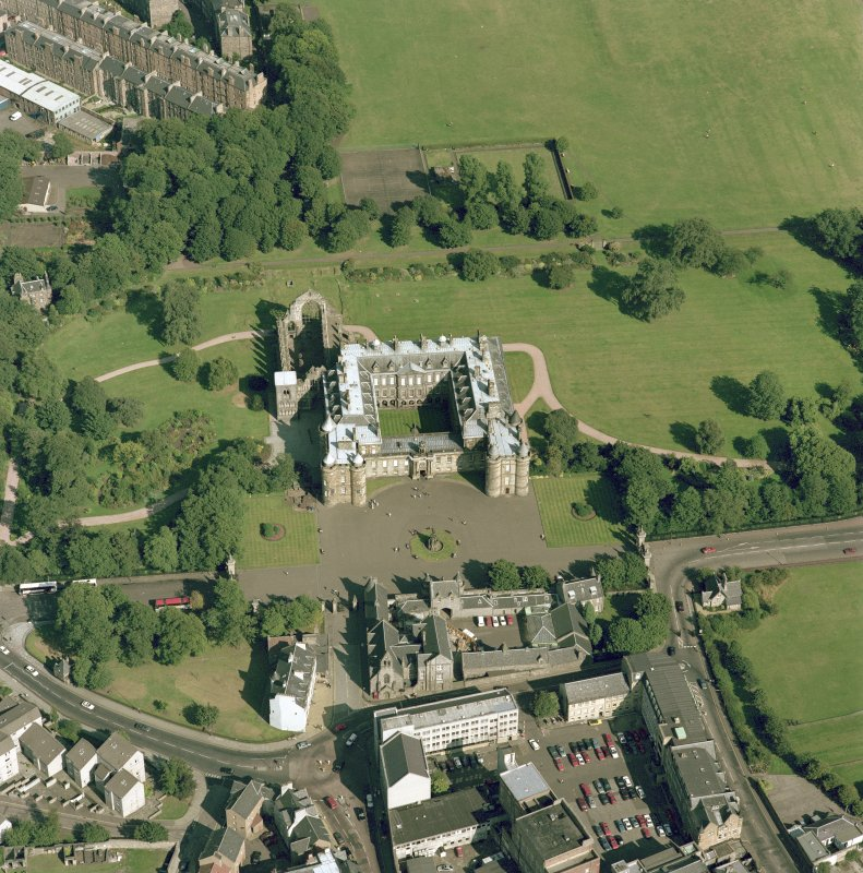 Oblique aerial view of Edinburgh centred on Holyrood Palace and Abbey, taken from the WNW.