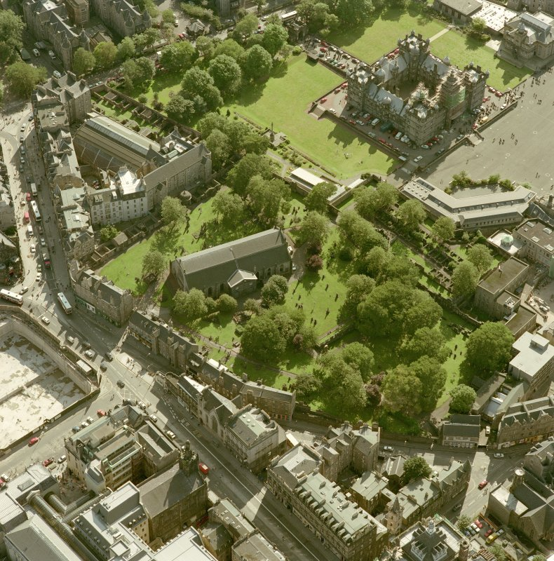 Scanned image of oblique aerial view, taken from the NNE, centred on Candlemaker Row, Greyfriars Church and burial-ground.