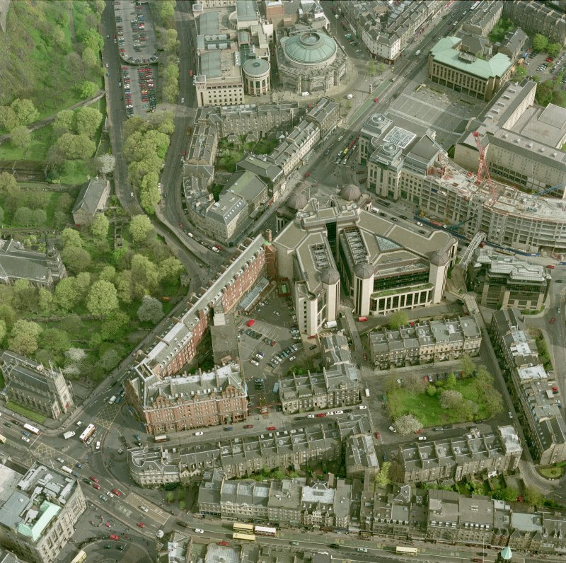 Oblique aerial view of Edinburgh centred on the Caledonian Hotel and Standard Life building, with Rutland Square adjacent, taken from the NW.