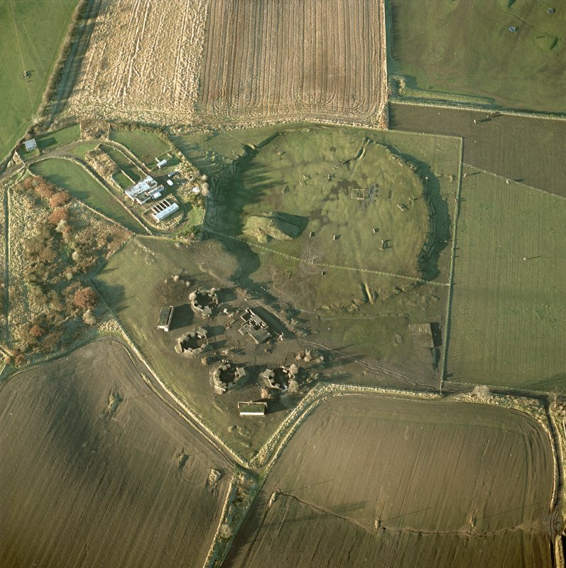 Oblique aerial view showing gun-emplacements and remains of the radar system.