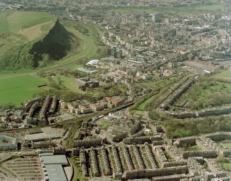 General oblique aerial view of Edinburgh centred on the construction of the Scottish Parliament with the exhibition centre and palace adjacent, taken from the N.