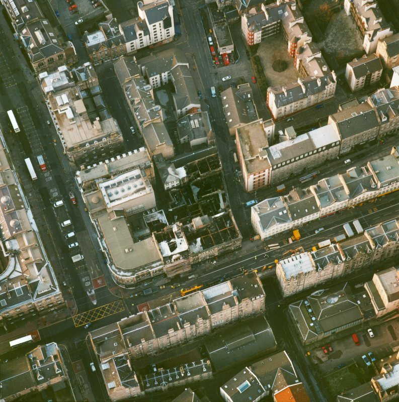 Oblique aerial view centred on the fire-damaged site at South Bridge, Edinburgh.