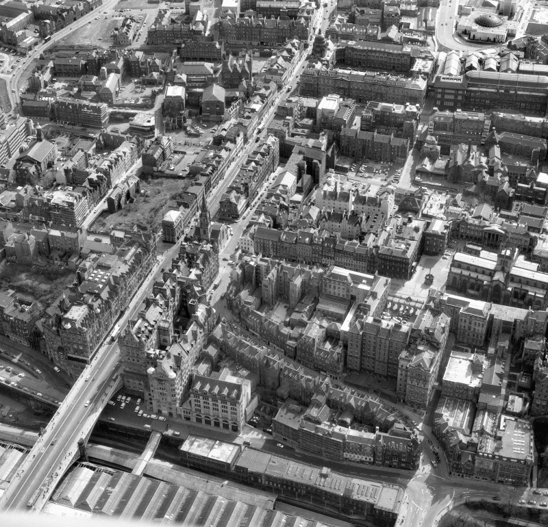 Oblique aerial view showing High Street between North Bridge (on left of photo) and Lawnmarket with St Giles' Cathedral on far right of photo, City Chambers at centre right and Cockburn Street at bottom.