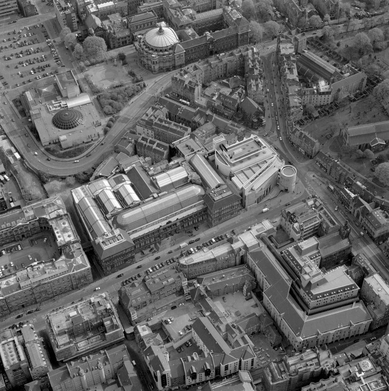 Oblique aerial view of Edinburgh centred on the Museum of Scotland, taken from the NNE.