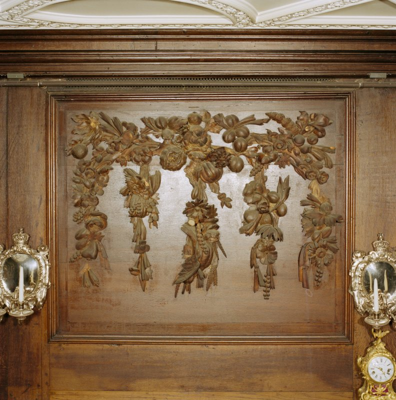 Interior, principal floor, dining-room, detail of carved wooden panel above fireplace. Digital image of D 41634/cn