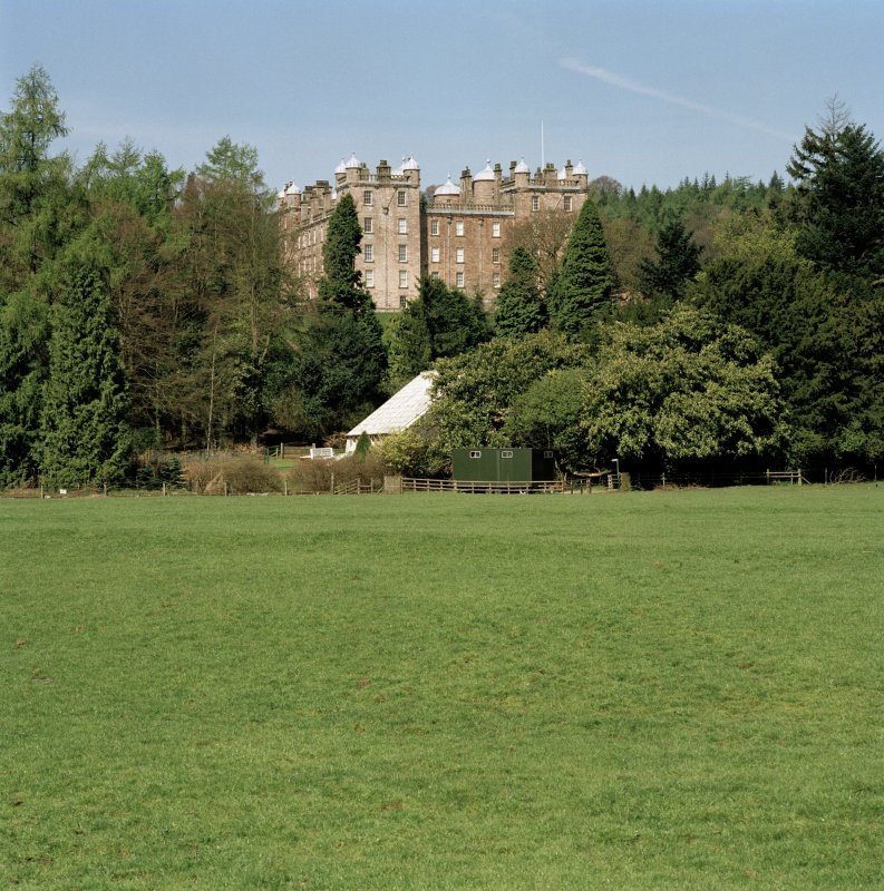 Distant view of castle through trees to South East. Digital image of D 47006/cn