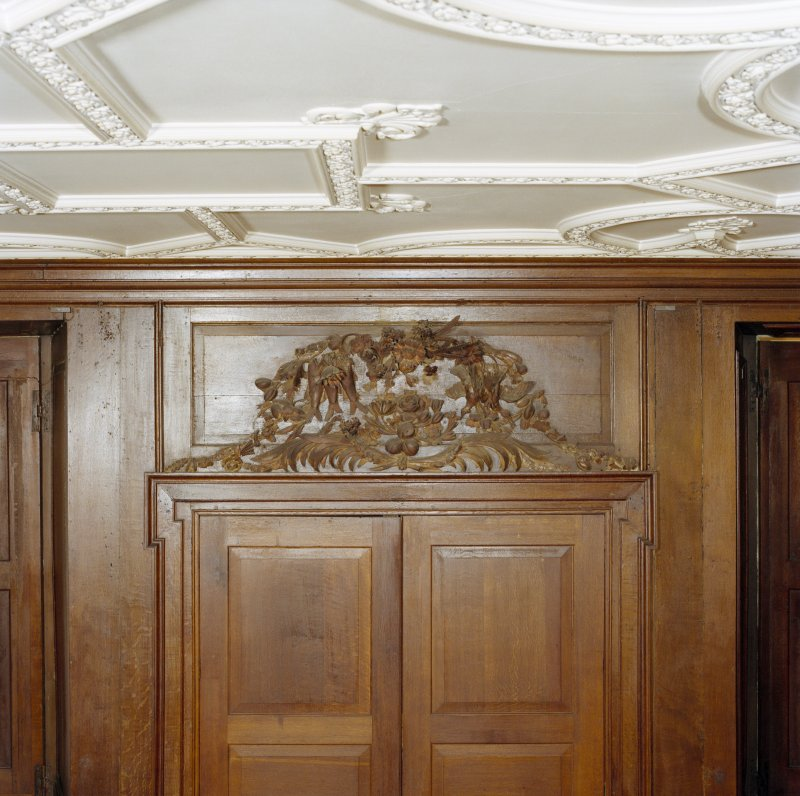 Interior, principal floor, dining-room, detail of carved wooden panel above door to outside stair. Digital image of D 41642 cn