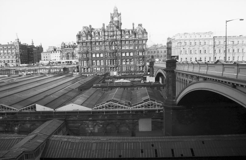 View from SSE showing W end of Waverly Station, with WSW front of North Bridge in foreground, North British Hotel in middle background and GPO building in right background