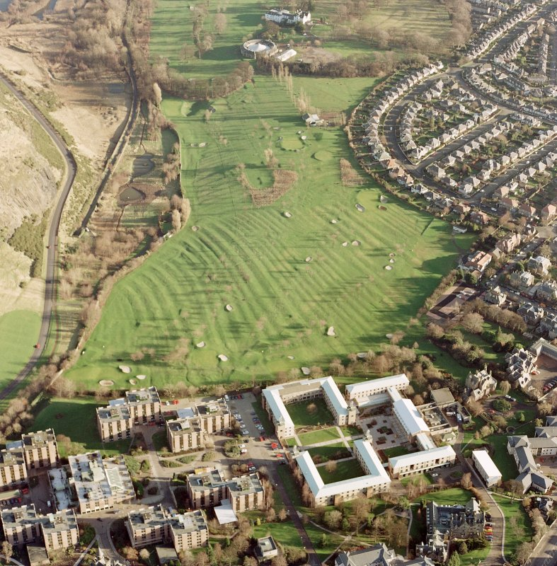 Oblique aerial view of Prestonfield centred on a golf course and rig, taken from the WNW.