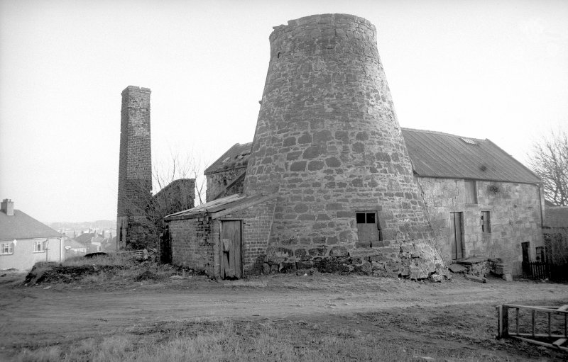 View from NW showing tower with WNW and NNE fronts of mill block