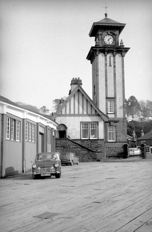View from SSW showing SSW front of clock tower and part of station building