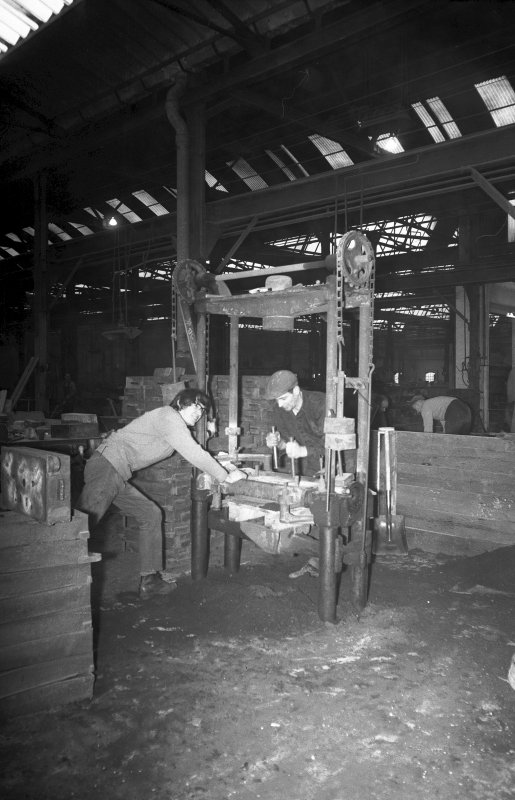 Interior View showing men working on hand-moulding machine