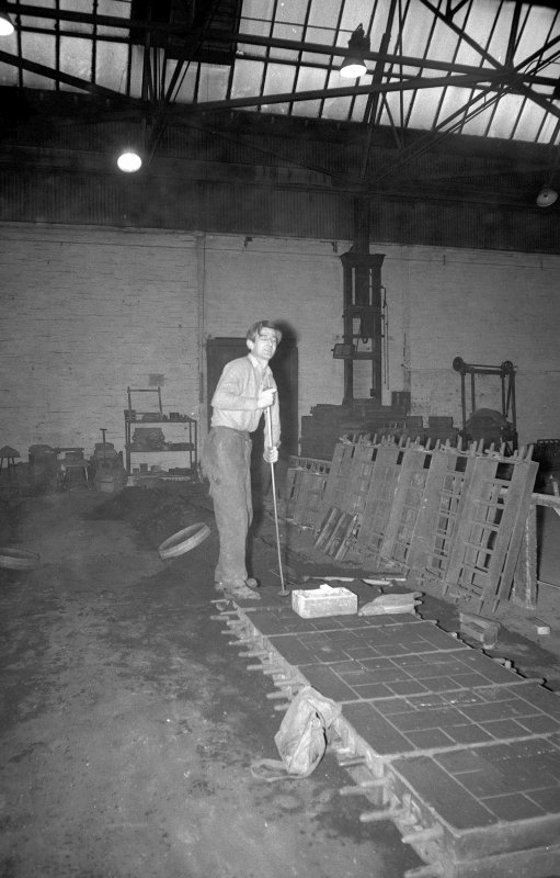 Interior View showing man hand-ramming the moulds