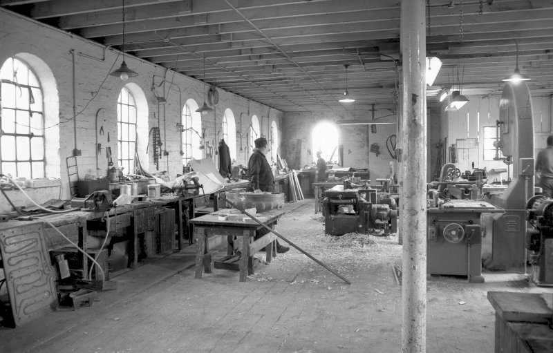 Interior View showing men working in pattern shop