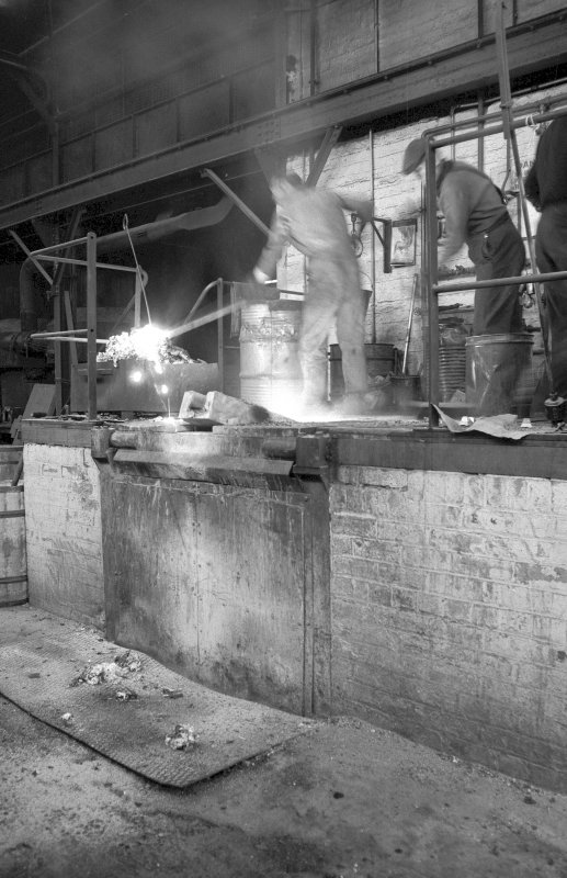 Interior View showing men working induction furnace