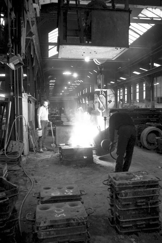 Interior View showing man pouring steel into mould