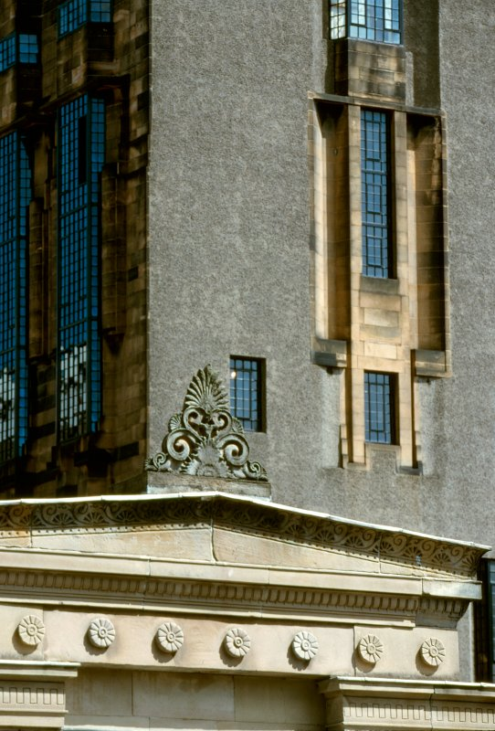 Digital image of Grecian roof detail with School of Art behind.