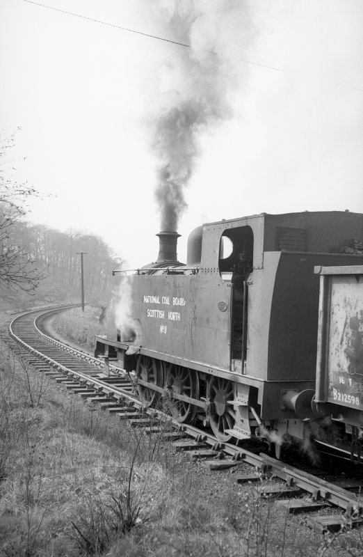 View from NNE showing NCB locomotive 060T no 9 departing colliery