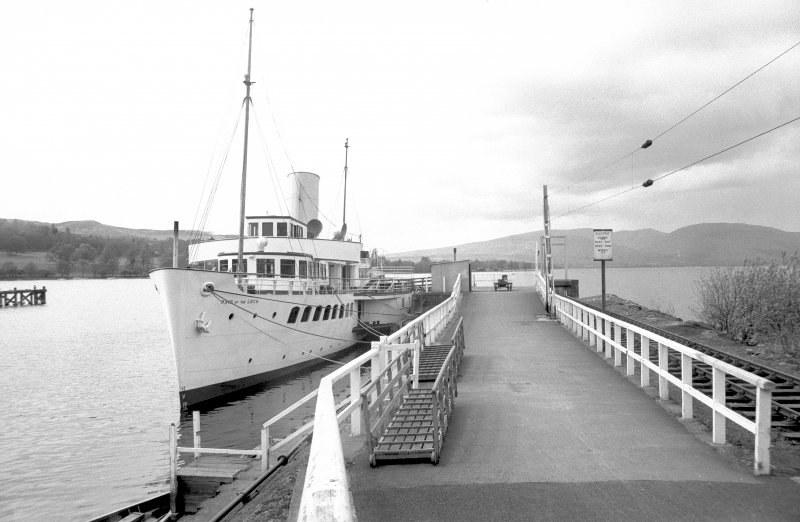 View from ESE looking down pier with Maid of the Loch docked
