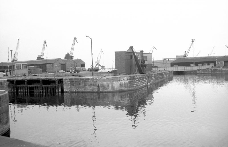 View from S showing crane and part of N lock gate at entrance to Albert Dock