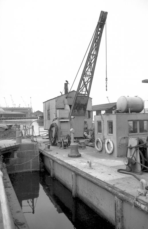 View from SE showing barge Grab no 1 and crane