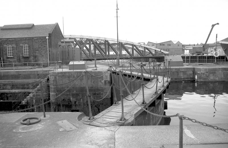 View from NNE showing dry dock gates with NNW front of bridge in background